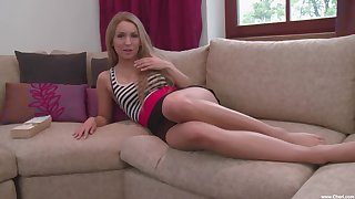 Whitney Conroy masturbates on the couch using fingers and imagination