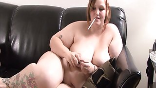 Curvy BBW with nice ass posing seductively on sofa while smoking