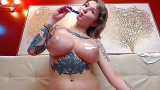 Amateur big tits MILF tattoed oiled boons on webcam