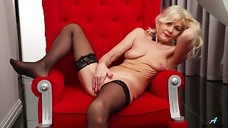 Mature blonde slut Sylvie takes off her black panties to play
