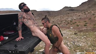 Excellent outdoor gay porn with two naked hunks on fire